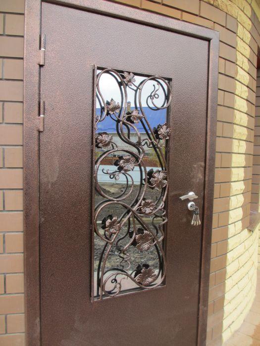 двери входные метал стекло